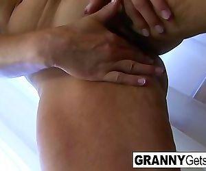 Busty bikini granny..