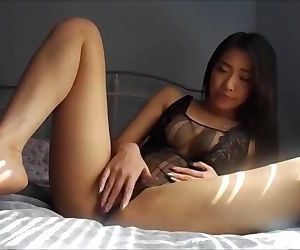 Asian Babe masturbating..
