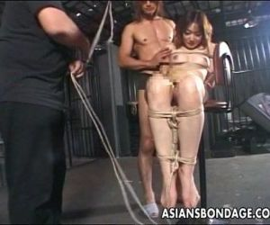 Asian hottie tied up to..