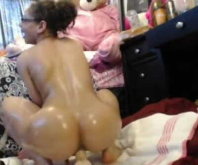Oiled girl plays with..