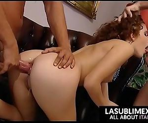 Redhead fucked by two..