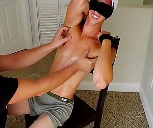 Sexy boy tickled in chair