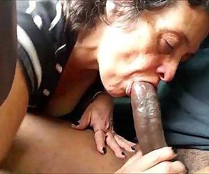 Mature lady sucks a..