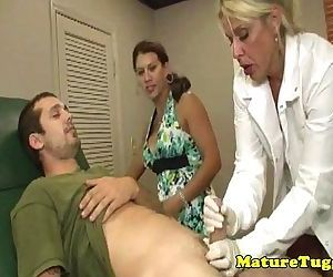 Busty milf dr tugs cock..