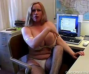 Busty cougar in fishnet..