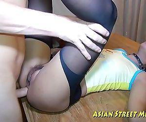 Asian Woman Dribbles..