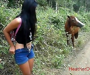 peeing next to horse in..